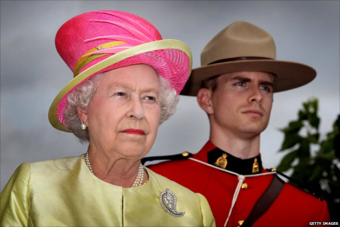 Queen Elizabeth forced to smile and wear this hat by Canadian Special Forces Sniper during visit to Toronto