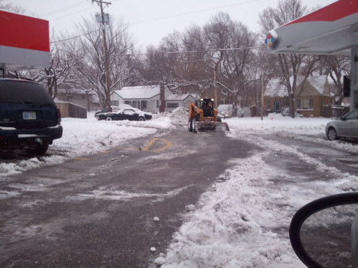 clearing the kwik shop parking lot in wichita, ks. 2/21/2013