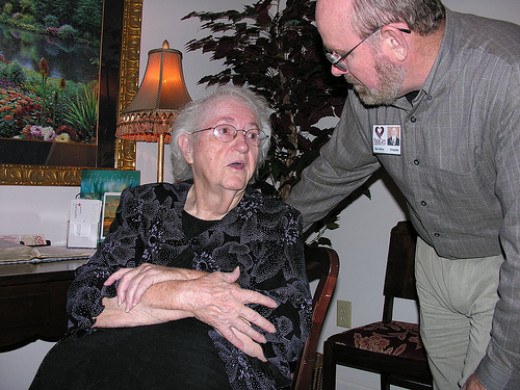 The hospice chaplain supports the patient and the caregiver.