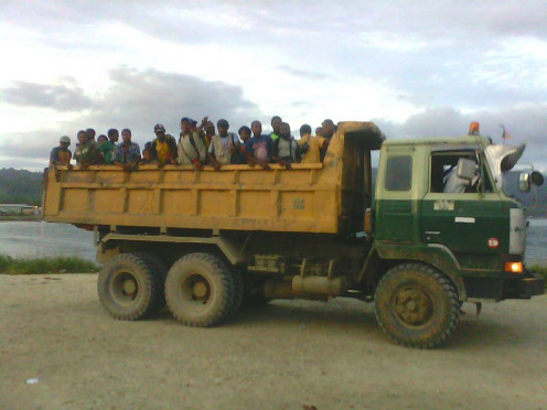 The only suitable transport to town for workers from Amanab, a remote station in PNG, only recently linked to town by logging roads.