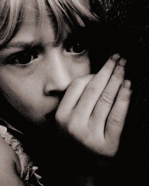 A scared child shows fear in an uncertain environment.
