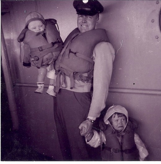 We were coming back to the US on a ship, and there was a drill, and I did not look too happy.  My brother was only 6 months old.  My dad was happy then.