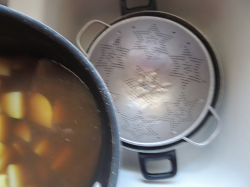 Drain potatoes, and reserve cooking broth in separate pot.