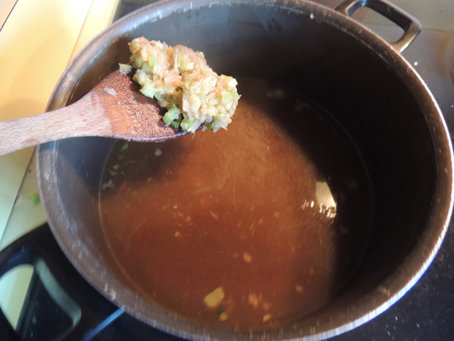 add shallots & celery mixture to reserved cooking stock. Add Bay leaves. Return to heat. Stir thoroughly, and leave be for a second.