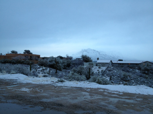 Snow covered Santa Catalina mountains for wintery backdrop over these north Tucson homes.