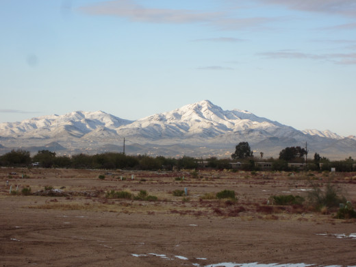 Snow covered Tucson Mountain Range at west end of Tucson, AZ