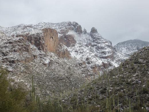 Finger Rock atop snow covered slopes of Santa Catalina Mountains in Tucson, Arizona.