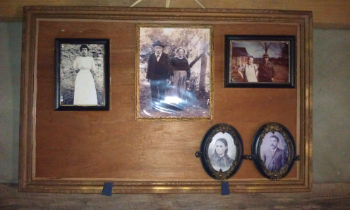 Photos of the Waldensians over the mantel inside  the Refour House at the Trail of Faith in Valdese, NC.