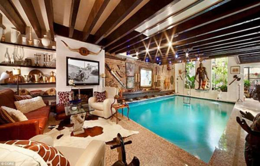Rustic Living Room with Wood Beam Ceiling and Indoor Swimming Pool
