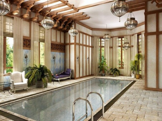 Moroccan inspired eclectic design living room with an indoor swimming pool - superb execution of evergreen interior design options