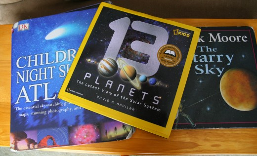 Many children's books about space are outdated and contain incorrect information. The most modern books for kids, including 13 Planets by David A. Aguilar, are beautiful and accurate sources of information for kids.