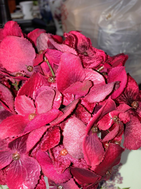 One of my favorite red silk flowers is the red hydrangea. This example shows lots of color variation among the flowers.