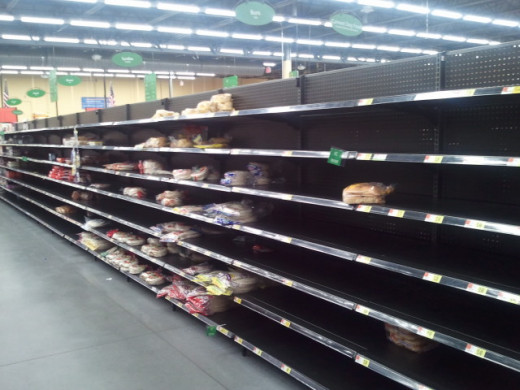 yet another set of empty bread shelves as people prepare for round 2 of the snowstorm in wichita, ks 2/24/2013