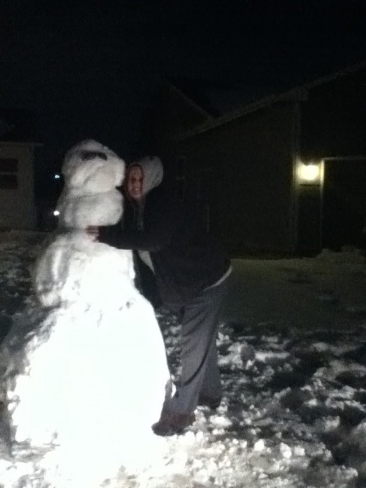 me chillin' with frosty the snowman after he showed up in our yard prior to round 2 of the wichita, ks snowstorm! 2/24/2013