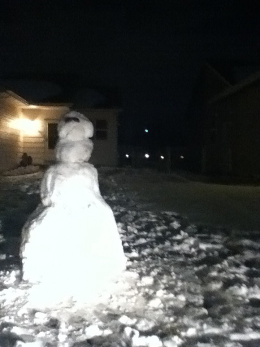 frosty the snowman chillin' in my front yard waiting on round 2 of the snowstorm in wichita, ks 2/24/2013