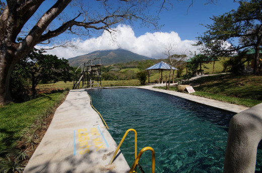 The warm water swimming pool at El Guyacán that has a million-dollar view of Volcano Miravalles.