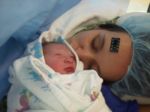 The very first time my daughter saw her baby after 18 hours of labor and a frightening emergency C-Section.