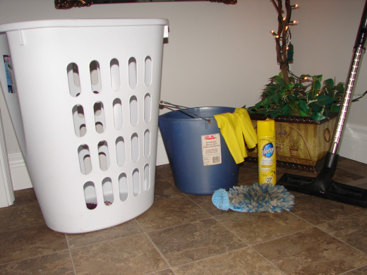 Cleaning supplies and an EMPTY clothes hamper!