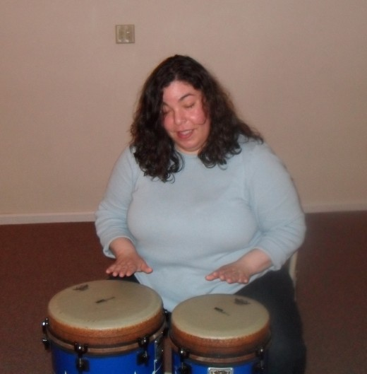 The author, playing bongo drums at a drum circle meetup in 2010