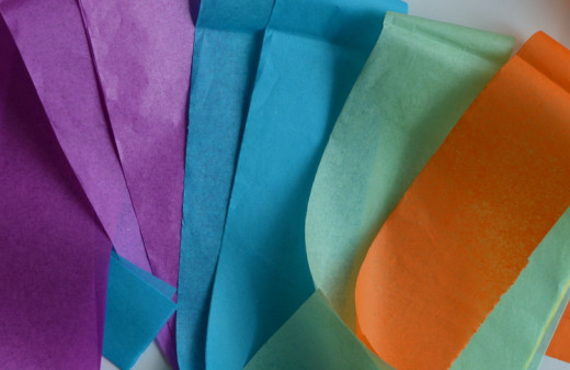 Go ahead and cut a lot of paper - you'll eventually have several layers on each balloon.