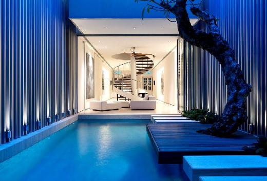 Fantastic indoor swimming pools living rooms with lap lanes included for Indoor swimming pool room design
