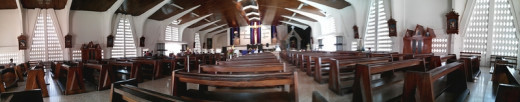 A 180-degree view of the inside of the central Catholic Church in Liberia.  The camera already has a wide-angle view, and the panorama feature makes banner-like photos possible.  The panorama shot is incredibly easy to do.