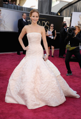 Jennifer Lawrence wears a dress by Dior Haute Couture