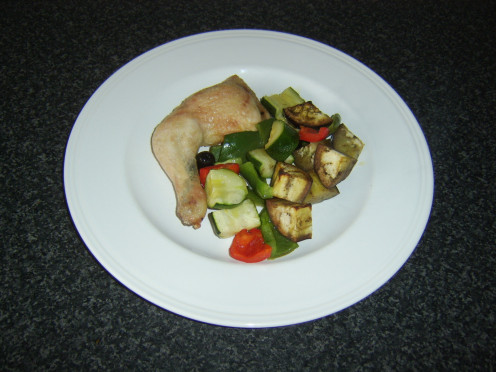 Garlic and thyme roast chicken served with an assortment of roasted Mediterranean style vegetables