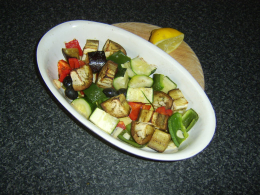 Lemon juice is squeezed over the roasted vegetables