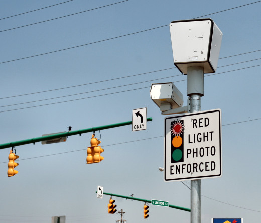 Intersections with red light cameras usually have warning signs.