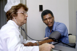 Patient has his blood pressure monitored