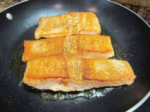 Turn the salmons over;  cook 3 more minutes or until they feel firm to the touch. Transfer to a plate and serve as desired.