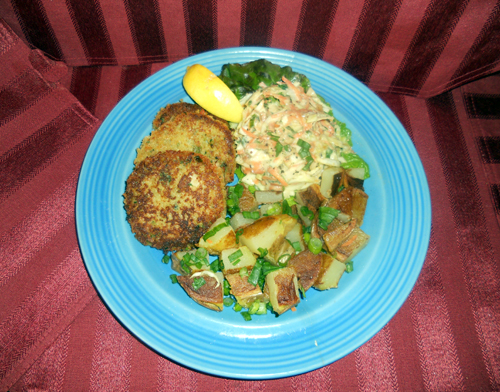 Serving Suggestion features home-made crab-cakes with all fresh crab meat, and roast potatoes. Check back for the crab cake recipe!