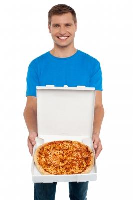 Smiling man enjoying his non-sequestered pizza is courtesy of FreeDigitalPhotos.net / stockimages