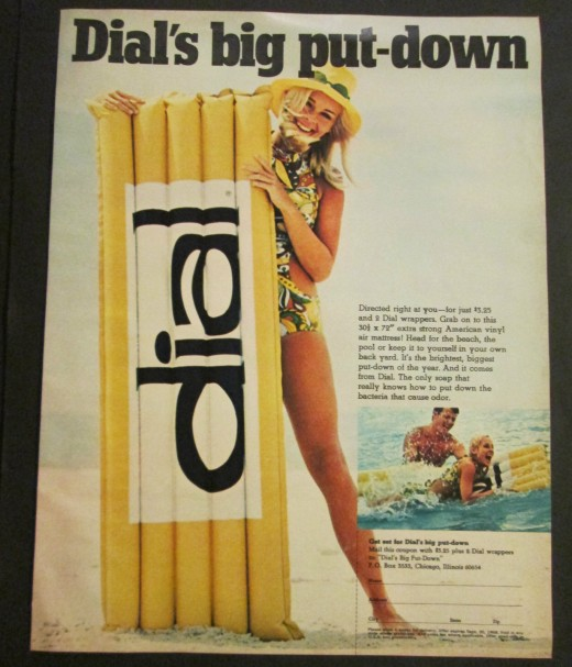 "vintage advertisement for Dial soap with blond girl in swim suit and a yellow lounge float with the words ""dail"""