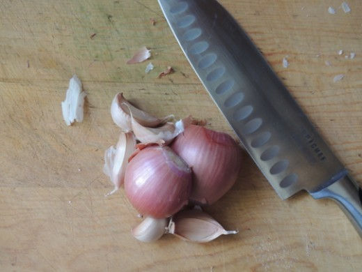 dice cloves and shallots