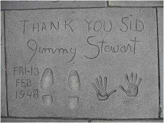Grauman's Theater in Hollywood with Jimmy Stewart's hand and footprints