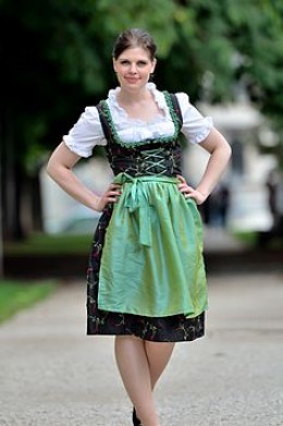 Dirndl - a light circular cut dress, gathered at the waist, that falls below the knee. The corset style lace up allows you to adjust it to size