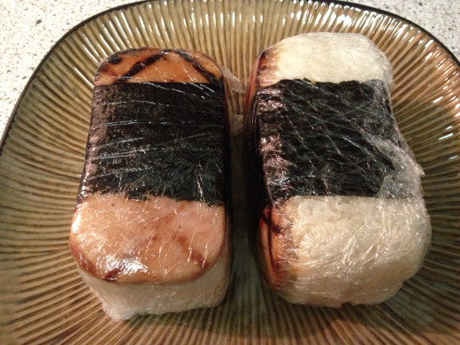 On the go food - musubi is wrapped in Saran Wrap and ready for lunch, road trip, etc.