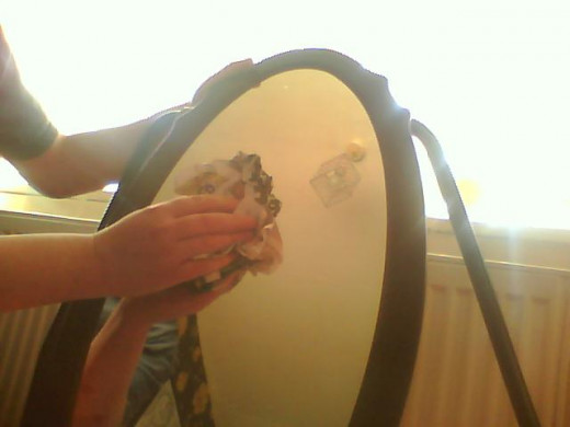 Off with dry news paper, as you can see the mirror is spotless with no fibers on the surface and no streaks.