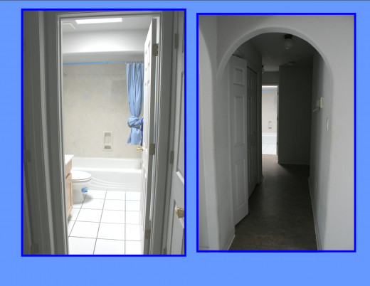 Hallway to bedrooms and second bath. Second bath has shower in tub with a skylight.