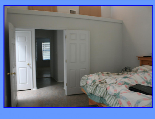 Double doors to Master Bedroom.  Vaulted ceiling with two clerestory windows. Note linen closet in hallway.