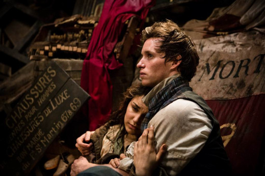 Samantha Barks and Eddie Redmayne in Les Miserables (2012)