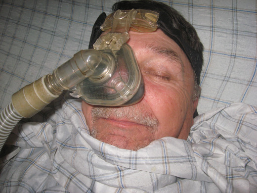 Hubby posing as a patient under general anesthesia.