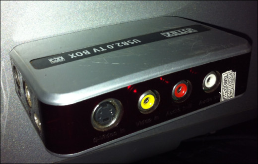 A USB TV set top Box spotting RCA cable jacks for video (yellow) and audio (Red and white)