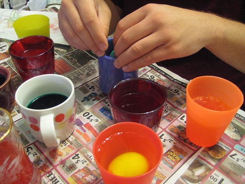 Dyeing Easter eggs with water and food coloring