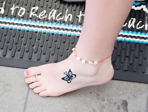 Butterfly tattoo in foot
