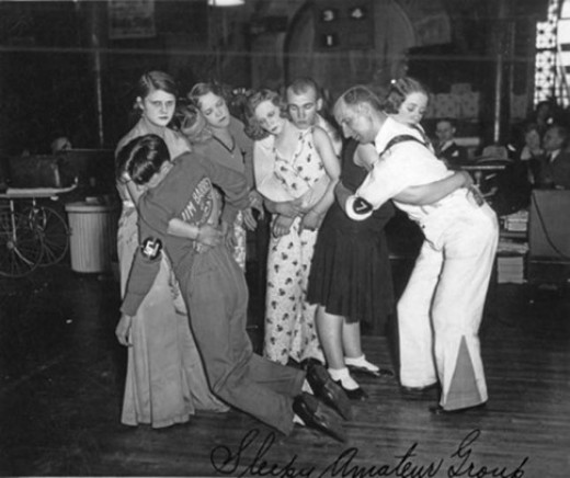 Last four couples standing in a Chicago dance marathon, ca. 1930.