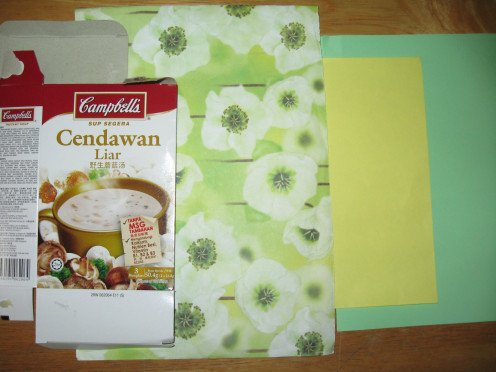 empty mushroom soup card box, green gift wrapper and some color construction papers