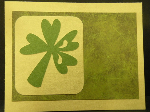 Shamrock/background adhered to card